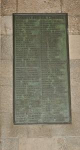 Una delle lapidi collocate nella Loggia dei Mercanti a Milano, in cui è ben visibile il nome di Righetto Giampiero nella prima colonna in alto.